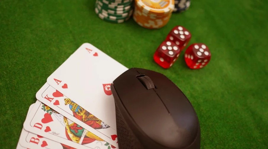 Mouse and poker cards on the table